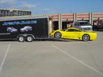 Saleen S7 being loaded off our trailer
