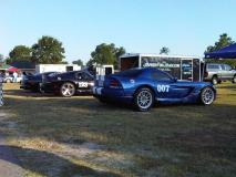 A Supra and two SRT/10 Viper Coupes in front of the hauler at Carolina Motorsports Park.